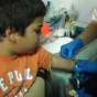Blood tests with Children in the SAM research project.