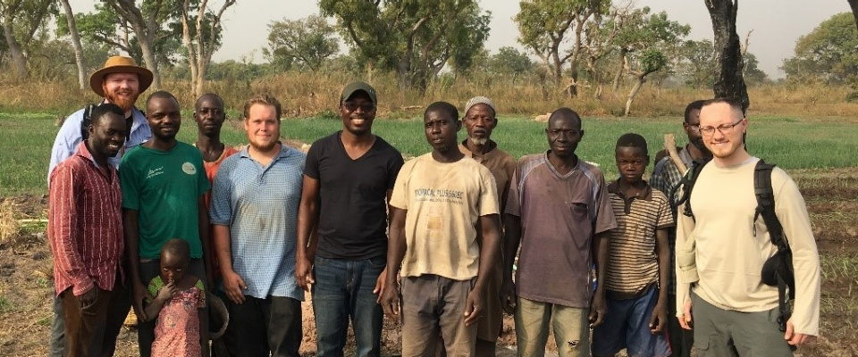 Geophysics research team with farmers from Kparigu, Northern Region after electromagnetic surveying and soil monitoring