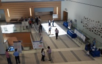 Overview of a group of research posters and speakers.