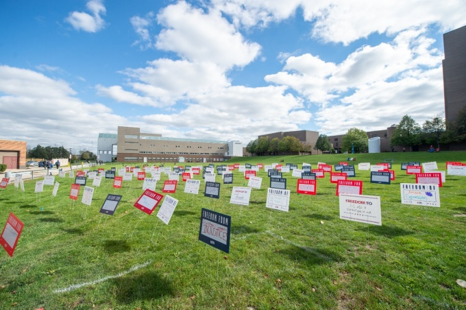 Student Union Field filled with For Freedom signs for Spirit Day.