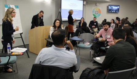 Faculty Discuss with students during small group session of the IP Forum.