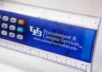 A detail photo of a blue and clear ruler with a calculator in it.