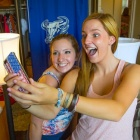 campus residents taking a selfie in their room