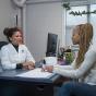 student in discussion with a u b healthcare provider.