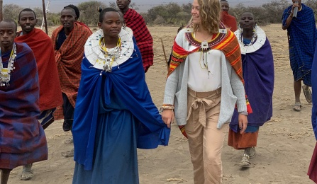 A picture of a student walking with members of the Maasai Tribe in Tanzania.
