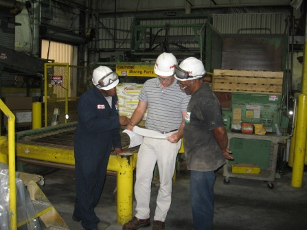 PeroxyChem workers review plans for their facility layout.
