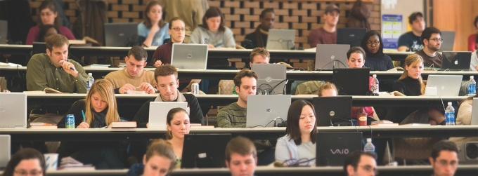 Students on laptops in a lecture hall