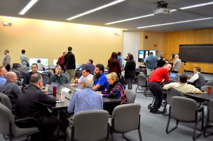 A group of IT staff discuss new and ongoing technology projects at UB.