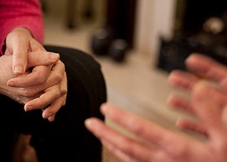 photo of hands of two people in conversation